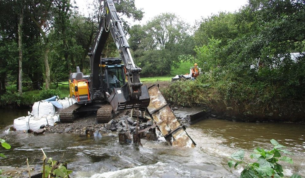 Weir lifted out
